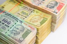 Ấn Độ: Nhu cầu đồng USD đẩy đồng rupee trượt giá