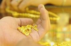 Đồng USD phục hồi khiến vàng châu Á mất đà tăng