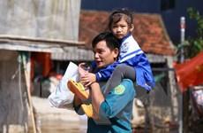 [Photo] Người dân vùng lũ Hà Tĩnh khắc phục khó khăn, ổn định đời sống