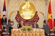 [Photo] Lễ ký kết các văn kiện hợp tác giữa hai nước Việt Nam-Lào