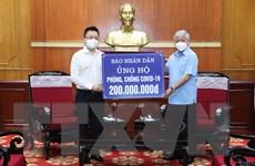 MTTQ Việt Nam tiếp nhận ủng hộ phòng, chống COVID-19 của báo Nhân Dân