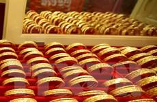 Giá vàng châu Á tiến gần đến mức cao nhất 6 năm qua