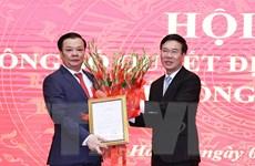 [Photo] Đồng chí Đinh Tiến Dũng giữ chức Bí thư Thành ủy Hà Nội