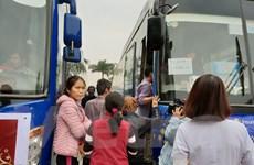 [Photo] 600 bệnh nhân về quê đón Tết trên chuyến xe miễn phí