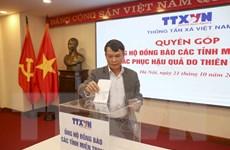 TTXVN ủng hộ đồng bào miền Trung khắc phục hậu quả do lũ lụt