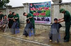[Photo] Giúp nhân dân là bổn phận, nghĩa vụ của mỗi người lính Cụ Hồ