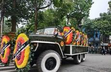 Đoàn xe đưa linh cữu nguyên Chủ tịch nước Lê Đức Anh rời Nhà tang lễ