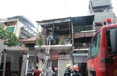 Hà Nội: Dập tắt đám cháy tại phố Hàng Ngang trong 20 phút