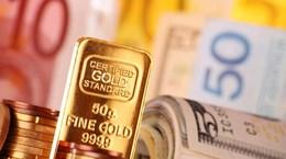 Đồng USD yếu đẩy giá vàng châu Á lên mức cao nhất trong gần 9 năm