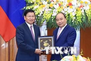 Thủ tướng đánh giá cao đóng góp của đoàn Lào tại WEF ASEAN 2018