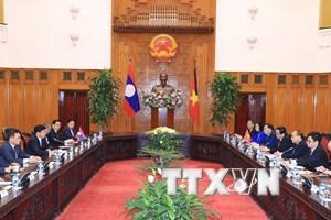 Thủ tướng Việt Nam-Lào thảo luận biện pháp thúc đẩy quan hệ hai nước