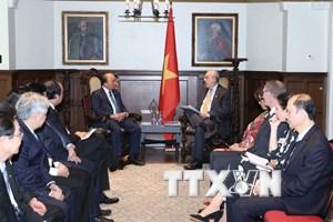 Thủ tướng gặp cựu Thủ tướng Canada J.Chretien và Tổng Thư ký OECD