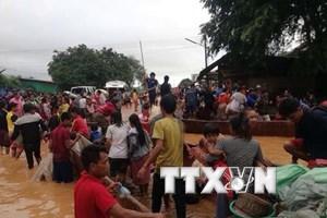 Binh đoàn 11 hỗ trợ Lào 1 tỷ đồng khắc phục sự cố vỡ đập thủy điện