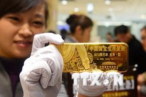 Vàng châu Á vẫn giao dịch ở gần mức thấp nhất trong hơn 3 tuần qua