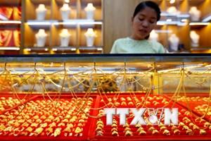 Giá vàng thế giới tụt xuống mức thấp nhất trong vòng 20 tháng qua