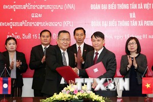 Hình ảnh Tổng Giám đốc TTXVN hội đàm với Tổng Giám đốc KPL