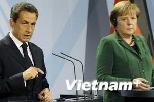 Lãnh đạo Đức và Pháp họp bàn cách cứu đồng euro