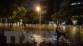 Trung Quốc khôi phục mức cảnh báo màu vàng về mưa bão