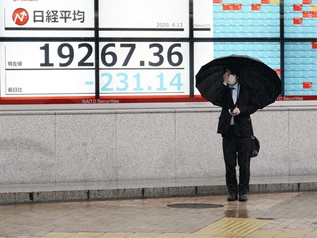 Thị trường chứng khoán châu Á tăng giảm trái chiều phiên 27/7 | Chứng khoán | Vietnam+ (VietnamPlus)