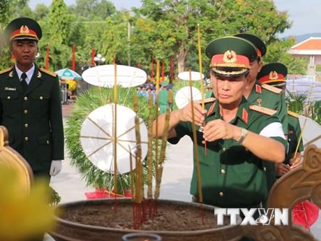 An táng 172 hài cốt liệt sỹ hy sinh tại Campuchia qua các thời kỳ | Xã hội | Vietnam+ (VietnamPlus)