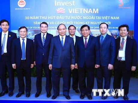Hình ảnh Thủ tướng dự Hội nghị 30 năm thu hút đầu tư nước ngoài