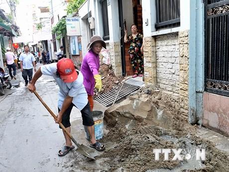 Lan tỏa phong trào hiến đất mở rộng hẻm tại Thành phố Hồ Chí Minh | Giao thông | Vietnam+ (VietnamPlus)