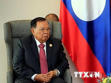 Tổng Bí thư Lào tiếp đoàn đại biểu cấp cao Đảng Cộng sản Việt Nam