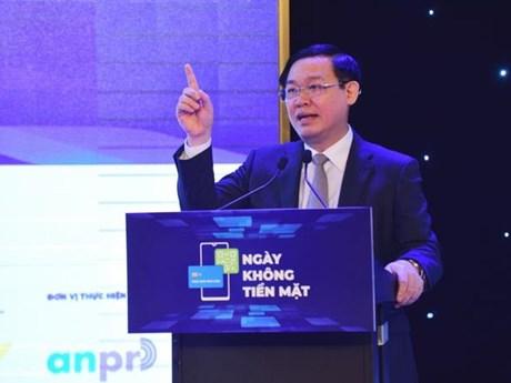 Thúc đẩy thanh toán không dùng tiền mặt giúp nền kinh tế minh bạch | Tài chính | Vietnam+ (VietnamPlus)
