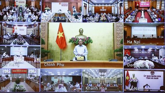 [Photo] Thủ tướng chủ trì họp trực tuyến toàn quốc về chống dịch
