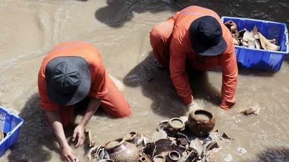 Tạm dừng công tác khai quật tàu cổ đắm ở cảng Dung Quất