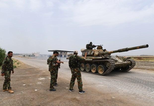 Quan doi Syria tang cuong truy quet khung bo tai Idlib va Hama hinh anh 1