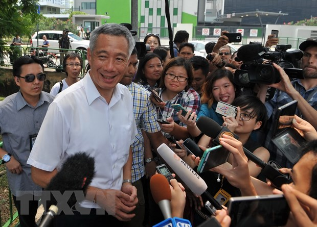 Bau cu Singapore: Dang cam quyen thang theo ket qua kiem phieu mau hinh anh 1