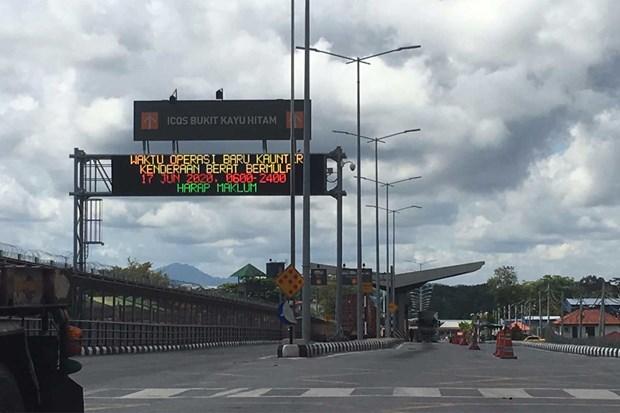 COVID-19: Malaysia dong cua mot tram kiem soat bien gioi voi Thai Lan hinh anh 1