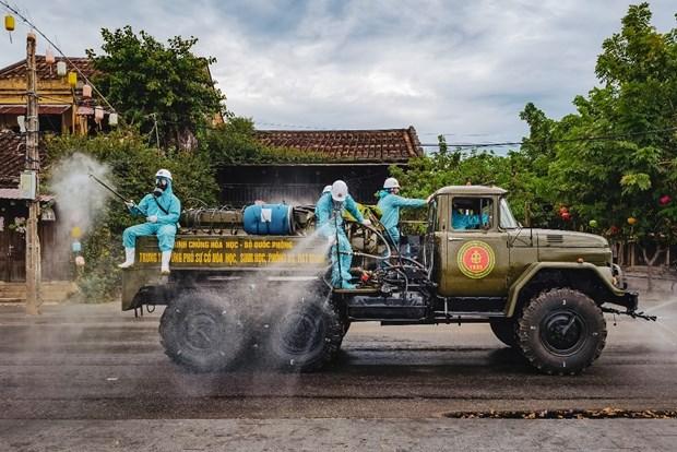 Hinh anh Viet Nam chong COVID-19 tren man hinh Quang truong Thoi dai hinh anh 6