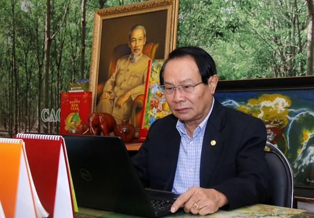 Cong dong nguoi Viet tai Lao gui gam niem tin vao su lanh dao cua Dang hinh anh 2