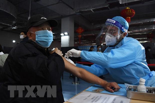 Trung Quoc khuyen khich nguoi dan tiem vaccine bang phieu giam gia hinh anh 1