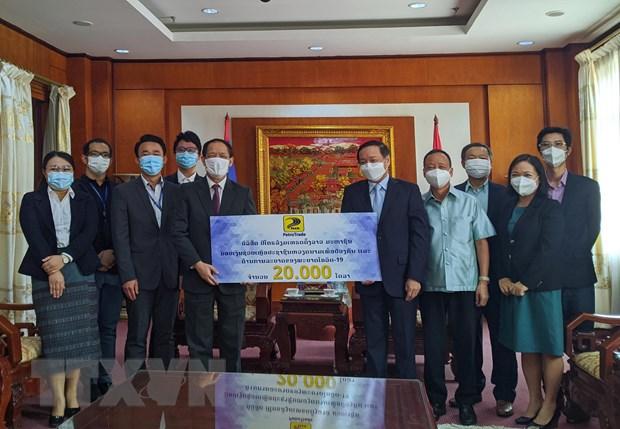 Lao ung ho Viet Nam 30.000 USD de ung pho voi dich COVID-19 hinh anh 2