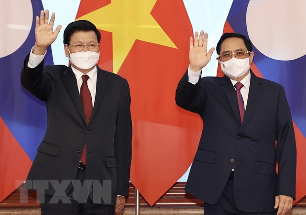 Thu tuong Pham Minh Chinh hoi kien voi Tong Bi thu, Chu tich nuoc Lao hinh anh 1