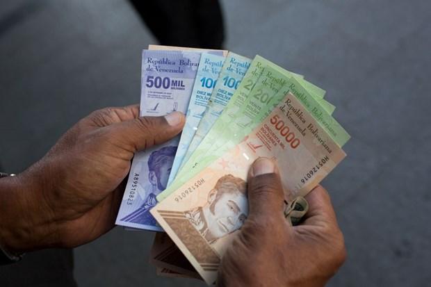 Venezuela tien hanh cai cach tien giay de doi pho voi sieu lam phat hinh anh 1