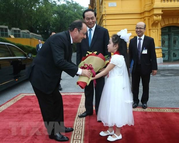 [Photo] Chu tich nuoc Tran Dai Quang don Tong thong Phap Hollande hinh anh 2