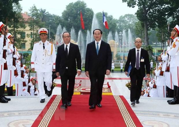 [Photo] Chu tich nuoc Tran Dai Quang don Tong thong Phap Hollande hinh anh 4