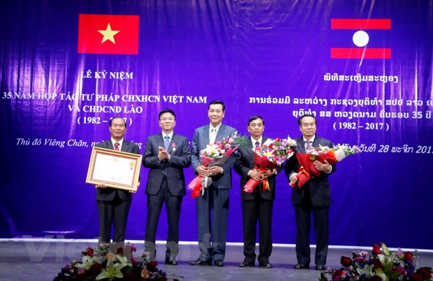 Lao se day nhanh thu tuc cho nguoi Viet xin nhap quoc tich nuoc nay hinh anh 2