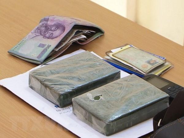 Bo doi Bien phong tinh Lao Cai bat doi tuong van chuyen 2 banh heroin hinh anh 1