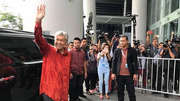 Vu Quy 1MDB: Chu tich dang doi lap UMNO tai Malaysia bi tham van hinh anh 1