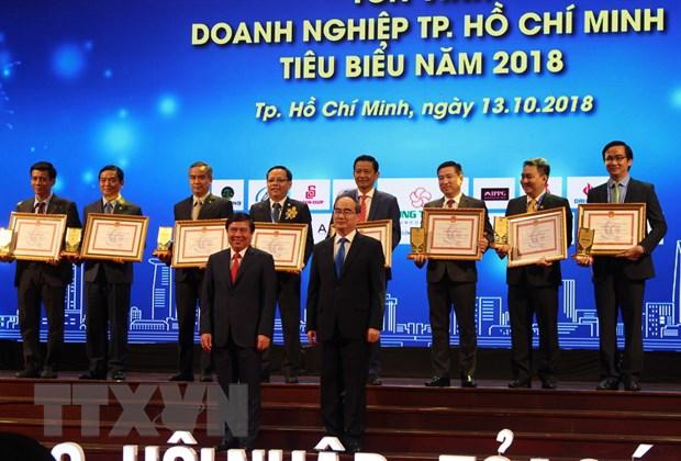 TP Ho Chi Minh ton vinh 99 doanh nghiep va 100 doanh nhan tieu bieu hinh anh 1