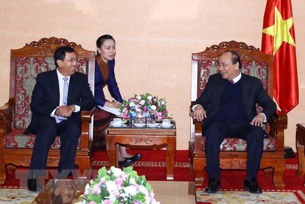 Thu tuong de nghi Ngan hang Nha nuoc Viet Nam tiep tuc ho tro Lao hinh anh 1