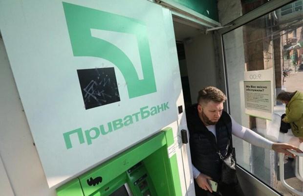 Tong thong Petro Poroshenko: Ukraine doi mat voi nguy co vo no hinh anh 1