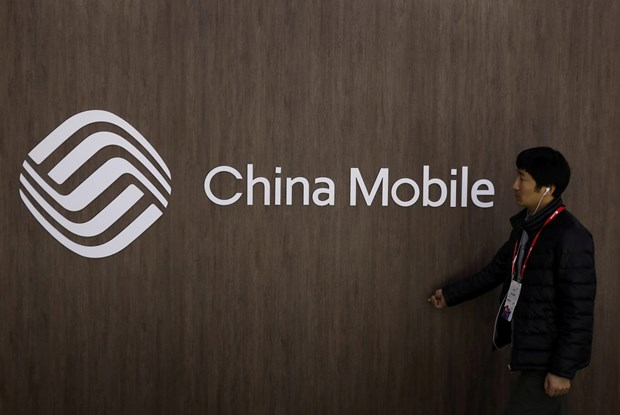 Trung Quoc chi trich My 'dong cua' voi cong ty China Mobile hinh anh 1