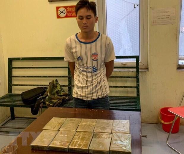Khoi to hai doi tuong van chuyen trai phep 20 banh heroin hinh anh 1