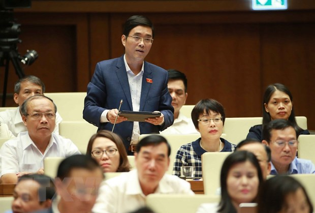 Bo truong Tran Tuan Anh: Giam 46% so luong doi quan ly thi truong hinh anh 1